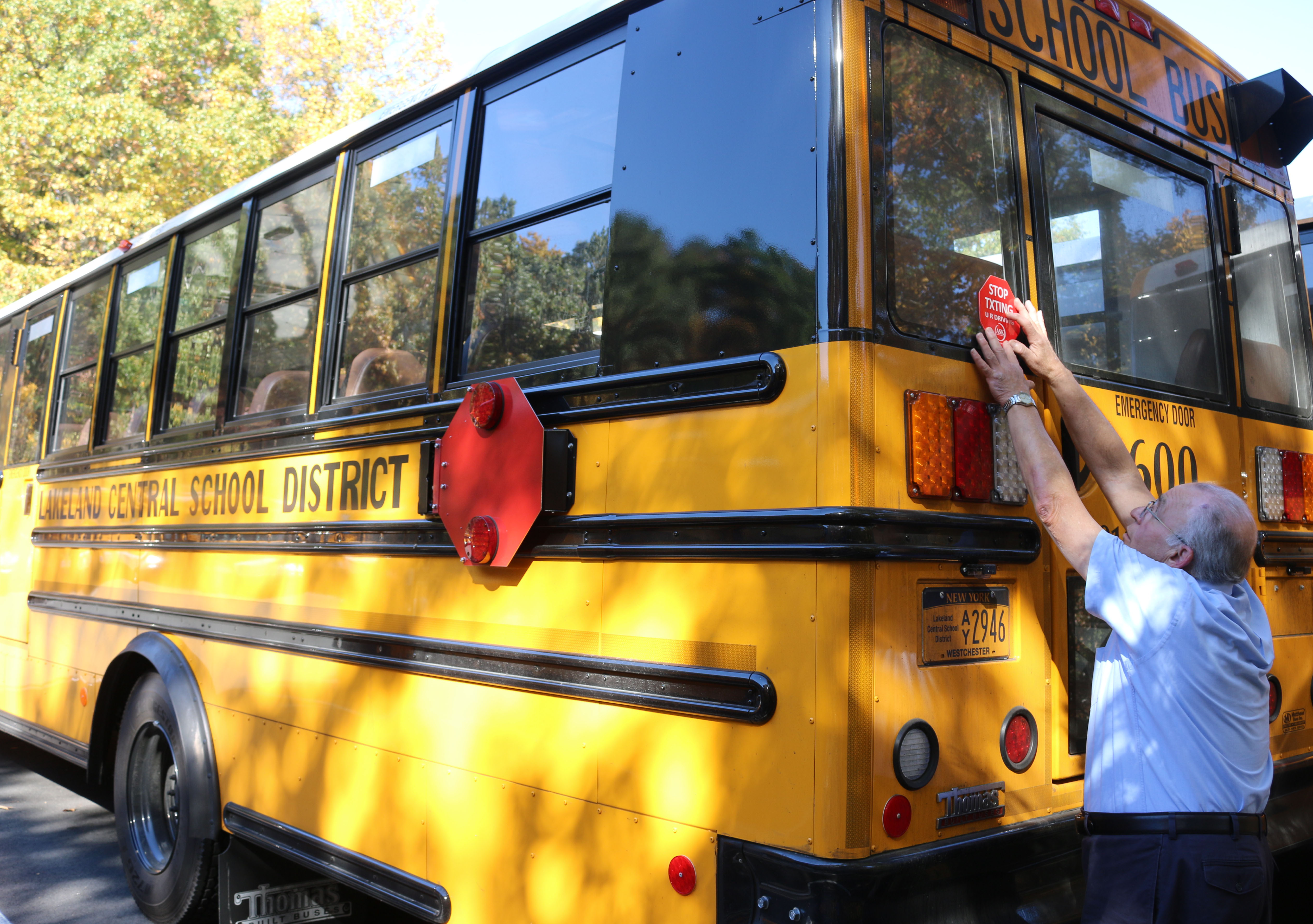 lcsd-transportation-assistant-supervisor-paul-cavaluzzi-placing-decal-on-bus